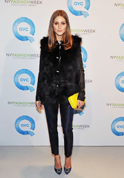 Olivia Palermo toyed with textures, pairing a furry coat with pleated jacquard cigarette pants.
