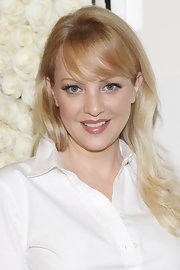 Wendi McLendon-Covey attended the QVC Red Carpet Cocktail Party wearing her blond hair long and tousled with wispy side-swept bangs.