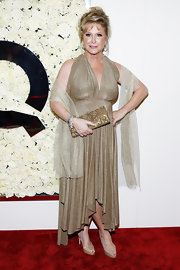 Kathy Hilton dazzled in a gold halter dress at the Buzz on the Red Carpet cocktail party.