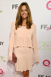 Kelly Bensimon chose a girly pink scoopneck sweater and a matching skirt for the FFANY Shoes on Sale event.