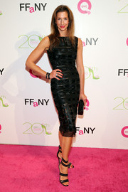 Alysia Reiner completed her ensemble with a pair of edgy-glam studded black sandals.