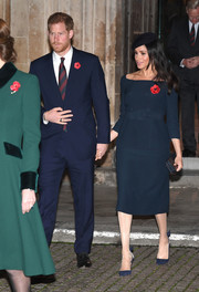 Meghan Markle kept it understated in a navy skirt suit with a bateau neckline at a service marking the centenary of the WW1 Armistice.
