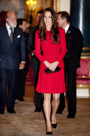 Kate Middleton was a vision in red at the Dramatic Arts reception.  She completed her look with a black clutch and classic pumps.
