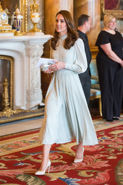 Kate Middleton paired her dress with cream-colored pumps by Emmy London.