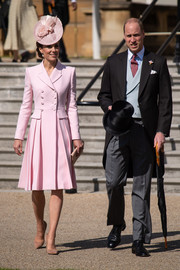 Kate Middleton looked sweet and chic in a pink coat dress by Alexander McQueen at the Buckingham Palace garden party.
