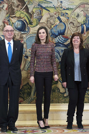 Queen Letizia of Spain kept it refined in a fitted purple tweed top while attending audiences at Zarzuela Palace.