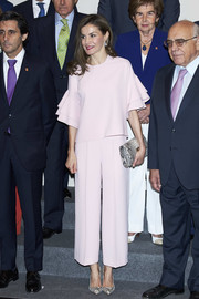 Queen Letizia of Spain looked very ladylike in a pale-pink Zara blouse with tiered ruffle sleeves while attending a Foundation Against Drugs meeting.