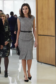 Queen Letizia of Spain attended the Rare Diseases World Day event wearing a fitted glen plaid dress by Hugo Boss.