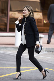 Queen Letizia of Spain visited the BBVA Foundation looking sharp in an embroidered black military jacket by Zara teamed with skinny pants.