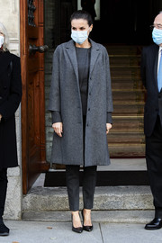 Queen Letizia of Spain kept it low-key in a gray tweed coat by Nina Ricci layered over a charcoal pantsuit at the FundeuRAE meeting.