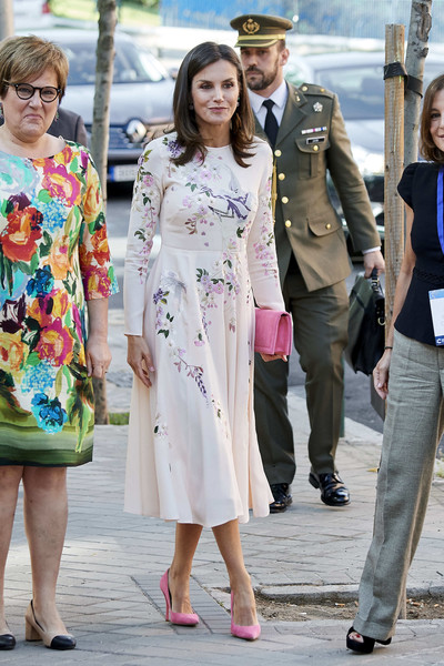 Queen Letizia of Spain was chic and ladylike at the AECC event in Madrid wearing pink Magrit pumps and a floral-embroidered dress.
