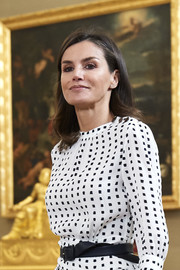 Queen Letizia of Spain paired a simple black leather belt with her print dress while attending audiences at Zarzuela Palace.