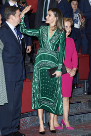 Queen Letizia of Spain looked refined in a green scarf-print midi dress by Sandro at the AFAMMER International Congress.