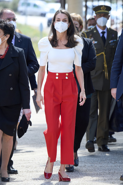 A pair of red block-heeled pumps completed Queen Letizia's look.