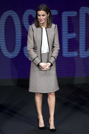 Queen Letizia of Spain kept it business-chic in a tweed skirt suit by Hugo Boss at a Rare Diseases Day meeting.