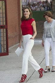 Queen Letizia of Spain attended Toma La Palabra wearing a red cap-sleeve blouse by Hugo Boss.