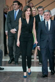 Queen Letizia style her look with a pair of teal suede mules by Magrit.