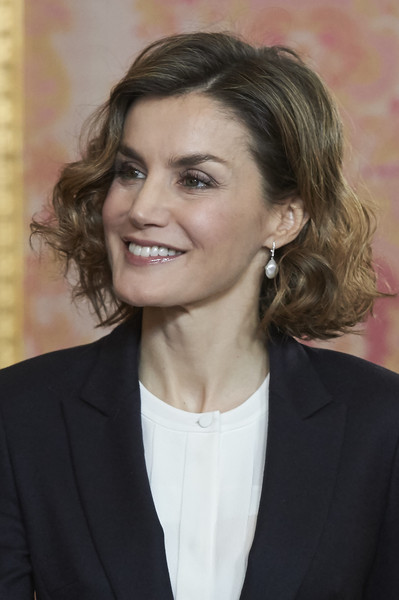 Queen Letizia of Spain Curled Out Bob [hair,hairstyle,chin,eyebrow,blond,white-collar worker,long hair,official,layered hair,suit,letizia,spanish royals meet,princesa de girona foundation,spain,princesa de girona foundation,madrid,royal palace]