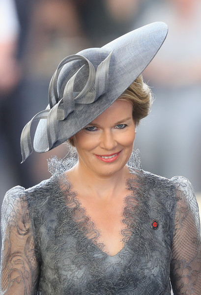 Queen Mathilde of Belgium Decorative Hat [the royal family attend the passchendaele commemorations,last post,clothing,hat,lady,beauty,fashion,fashion accessory,headgear,costume hat,ear,headpiece,mathilde of belgium,members,nations,commemorations,place,belgium,commonwealth war graves commission ypres,ceremony]