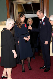 Kate Middleton chose a simple navy midi dress for the Royal British Legion Festival of Remembrance.