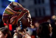 Lupita Nyong'o attended the 'Queen of Katwe' London premiere wearing a statement-making head wrap by Rosie Assoulin.