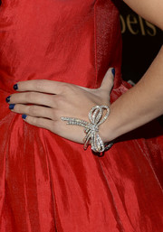 AnnaLynne McCord wore this swoon-worthy bow-shaped diamond bracelet to the Art of Van Cleef & Arpels event.