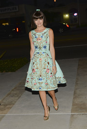 Camilla Belle totally charmed with her gold peep-toes and cocktail dress combo at the Art of Van Cleef & Arpels event.