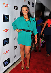 Faith Evans kept it simple and chic with a draped, turquoise mini dress.