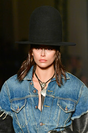 Kaia Gerber looked quirky wearing this oversized Chaplin hat at the R13 show.