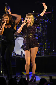 Taylor Swift teamed a pair of Marc Fisher ankle boots with a sequined romper for her performance at the We Can Survive concert.