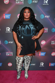 Lizzo punched up her outfit with a pair of over-the-knee snakeskin boots by Fashion to Figure.