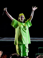 Billie Eilish performed at the We Can Survive concert wearing an oversized neon-green tee.