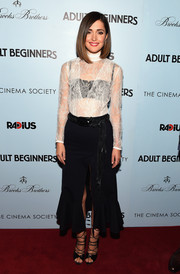 Rose Byrne flashed plenty of skin (along with her black bra) in a white lace blouse by Altuzarra during the New York premiere of 'Adult Beginners.'