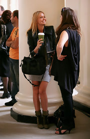 Lara wore an army green pair of black lace-up ankle boots. She was right on with the chic military trend.