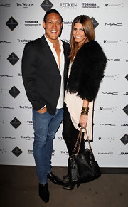 Sara Hills attended fashion week in Australia donning a fury coat and a black leather chain strap tote.