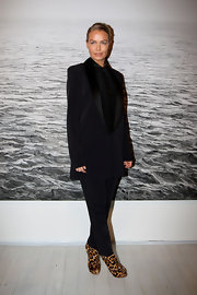 Lara Bingle gave her black pant suit an exotic twist with a pair of leopard print wedges.