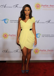 Sanaa paired her canary yellow frock with blue peep-toe pumps.