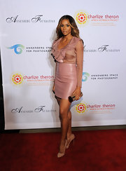 Ciara accessorized her blush-colored ensemble with nude patent leather pumps.