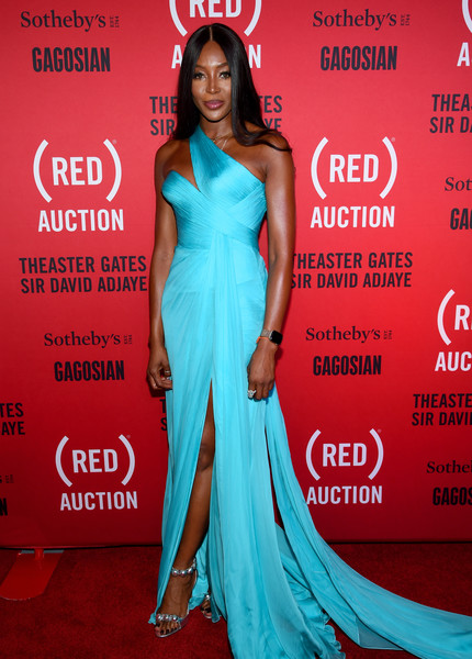 Naomi Campbell styled her dress with a pair of silver Alaia Bomb sandals.