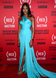 Naomi Campbell brightened up the red carpet with this turquoise one-shoulder gown by Atelier Versace at the (RED) Auction.