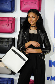 Chanel Iman teamed a Sameson Rose Gold Choker from Adornmonde with a black leather jacket and monochrome jumpsuit for the Reed x Kohl's Collection launch.