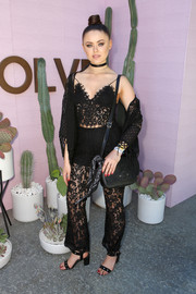 Kristina Bazan went matchy-matchy, pairing her top with black lace pants.