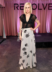 Rumer Willis displayed her toned torso in a sheer black blouse during the Revolve Pop-Up launch.