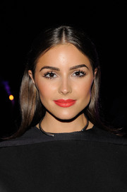 Olivia Culpo lit up her face with bright red lipstick.
