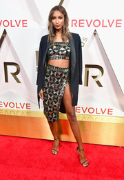 Jasmine Tookes donned an oversized tux jacket for a masculine-chic finish to her crop-top and high-slit skirt at the #REVOLVEawards.
