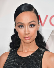 Draya Michele attended the #REVOLVEawards wearing her hair in a curly ponytail.