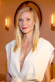 Gwyneth Paltrow styled her golden locks in a straight, parted cut.
