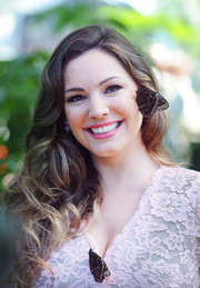 Kelly Brook showed off lush, bouncy curls at the RHS Hampton Court Flower Show.