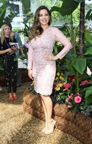 Kelly Brook slipped into a curve-flaunting pink lace frock for the RHS Hampton Court Flower Show.