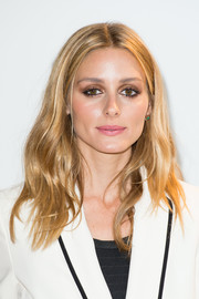 Olivia Palermo went for a sultry beauty look with a heavy application of neutral eyeshadow.